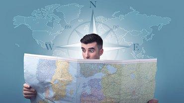 Mann Landkarte Position Kompass