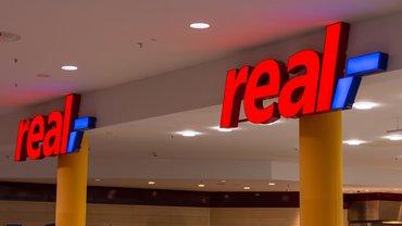 real,- Logo real Schriftzug